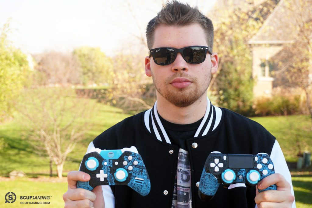 OpTic Crimsix with his custom Xbox One and PlayStation4 controllers